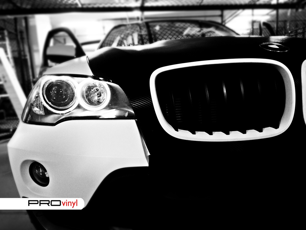 BMW X5 fully wrapped in matte white with carbon fibre bonnet | Sydney