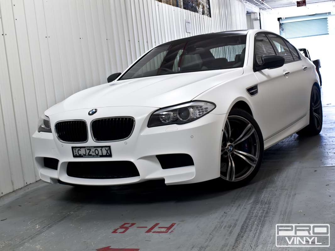 3M satin white wrap, with selected features picked out in black carbon fibre | Sydney