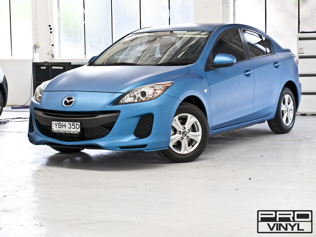 Mazda 3 with its sharp new metallic matte blue wrap