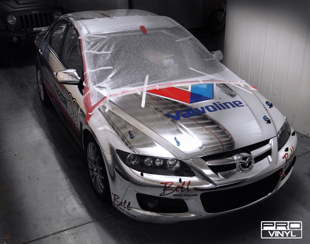 A full chrome wrap with signwriting for west end Mazda racing team | Sydney