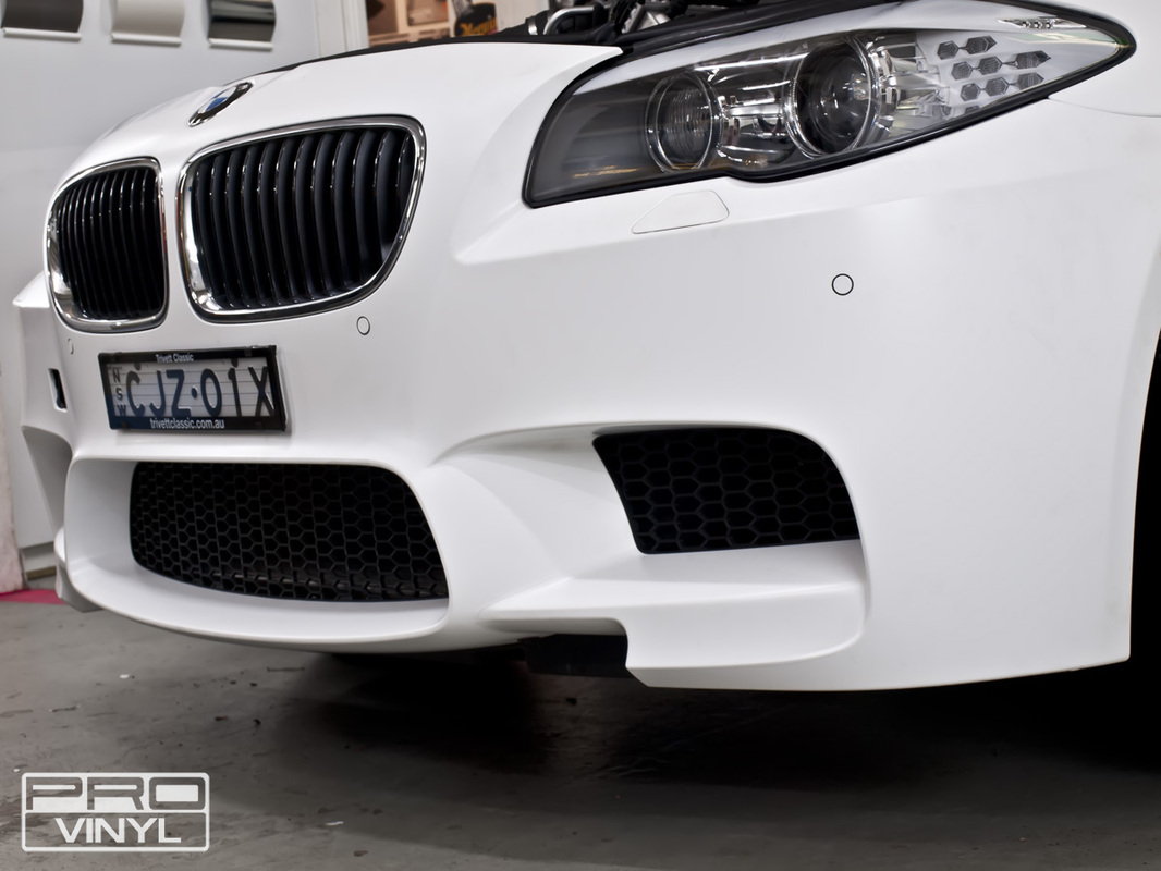3M satin white wrap, with selected features picked out in black carbon fibre