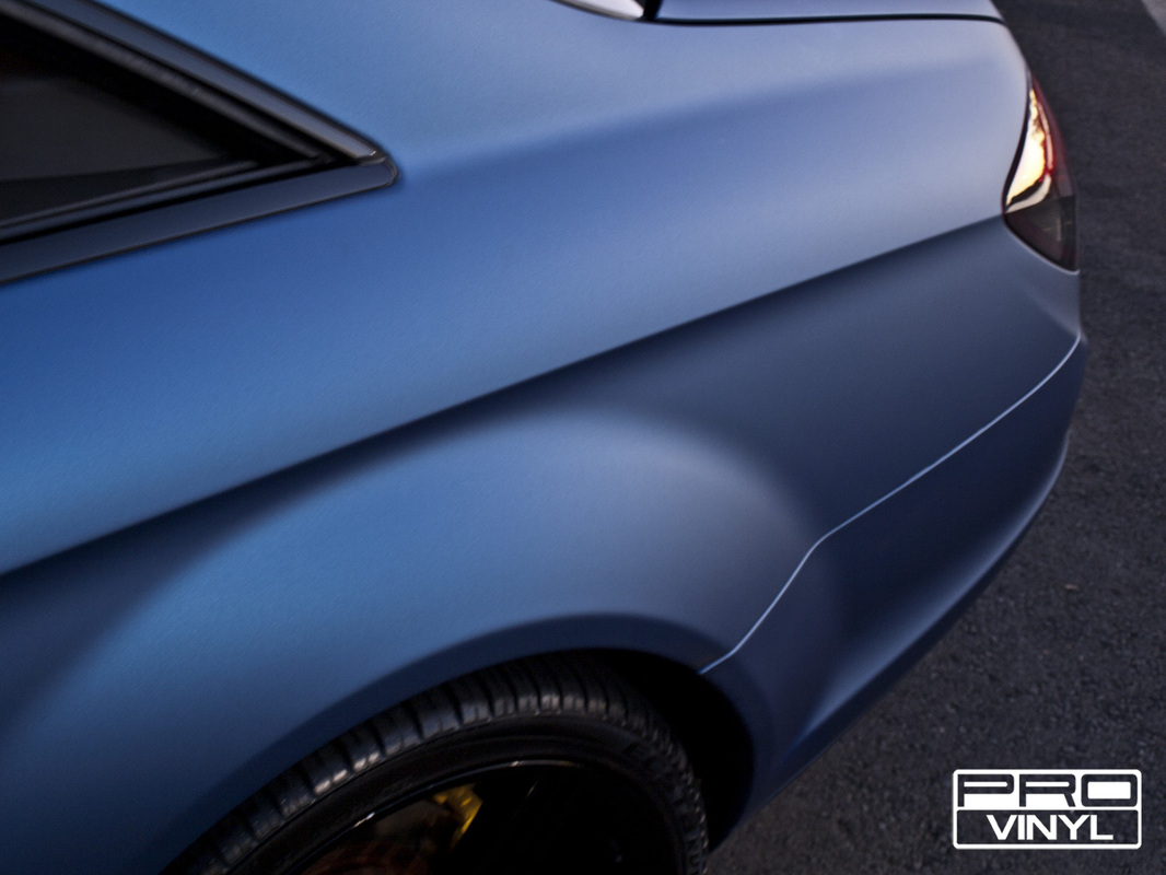 A matte metallic blue wrap